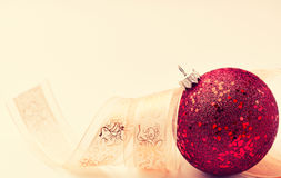 Red christmas ornament with satin ribbon Royalty Free Stock Photos