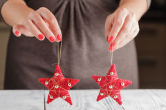 Red Christmas ornament in the shape of a star. Stock Photos