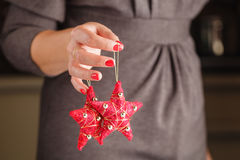 Red Christmas ornament in the shape of a star. Stock Photography