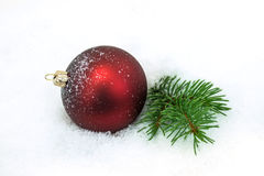 Red Christmas Ornament In The Snow. Decoration for xmas royalty free stock image