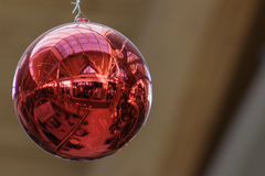 Red Christmas ornamental ball with close up of reflection Stock Image