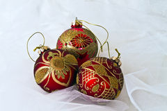 Red Christmas Ornaments. With netting background Stock Photos