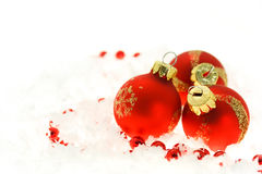 Red Christmas ornaments. On snow Stock Photography