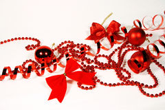 Red Christmas ornaments. Bows and beads Stock Photos