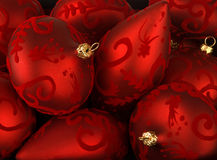 Red christmas ornaments. Close-up of embossed red christmas ornaments Stock Image