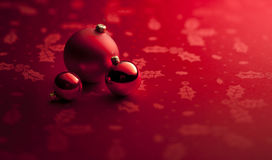Red Christmas Ornaments Banner Background. A small still-life of red Christmas ornaments on red background banner Royalty Free Stock Images