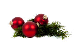 Red Christmas ornaments/baubles with pine branch Stock Image