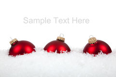 Red Christmas ornaments/baubles on white Royalty Free Stock Photo