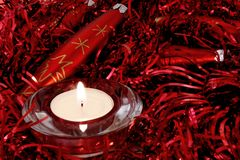 Red Christmas ornaments and candle Stock Photography