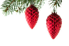 Red christmas ornaments cones on the xmas tree on white background isolated. Winter holiday theme Stock Image