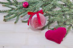 Red Christmas ornaments and a fir tree Stock Photos
