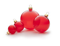 Red Christmas Ornaments. Four red Christmas ornaments on a white background Royalty Free Stock Photography
