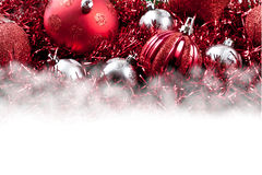 Red Christmas Ornaments and Garland above White Blank Space Stock Images