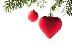 Red christmas ornaments heart and ball on the xmas tree on white background isolated. Merry christmas card. Winter holidays. Xmas theme Stock Image