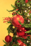 Red Christmas Ornaments on Lit Christmas Tree Stock Photography