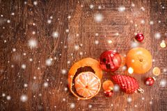 Red Christmas ornaments and orange on wooden holiday background. Xmas and Happy New Year composition stock photography