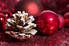 Red Christmas ornaments with pine cone Royalty Free Stock Photo