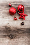 Red Christmas ornaments on a rustic wooden background. Xmas card. Happy New Year. Top view with copy space Stock Image