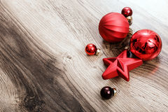 Red Christmas ornaments on a rustic wooden background. Xmas card. Happy New Year. Top view with copy space Stock Photography