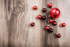 Red Christmas ornaments on a rustic wooden background. Xmas card. Happy New Year. Top view with copy space Royalty Free Stock Image