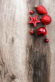 Red Christmas ornaments on a rustic wooden background. Xmas card. Happy New Year. Top view Royalty Free Stock Photos