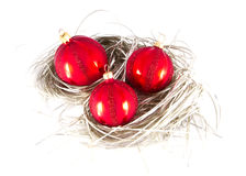Red Christmas ornaments on silver. Royalty Free Stock Photography