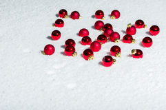 Red Christmas ornaments on snow Stock Photo