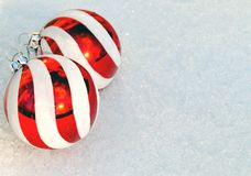 Christmas Card Design Red Ornaments on Snow Stock Photos