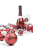 Red christmas ornaments with sparkling wine Royalty Free Stock Image