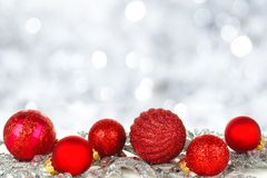 Red Christmas ornaments with twinkling background Royalty Free Stock Photos