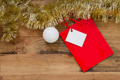 Red Christmas paper bag hanging on brown background Stock Photo