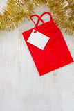 Red Christmas paper bag on white background Stock Photos