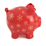Red Christmas piggy bank. Red piggy bank decorated with golden snowflakes, isolated on white background Stock Images