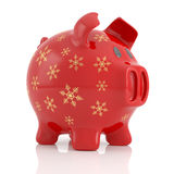 Red Christmas piggy bank. Red piggy bank decorated with golden snowflakes, isolated on white background Royalty Free Stock Photo