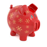 Red Christmas piggy bank. Red piggy bank decorated with golden snowflakes, isolated on white background Royalty Free Stock Photos