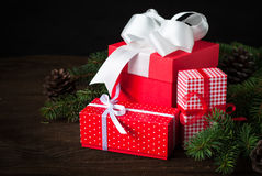 Red christmas present. Beautiful christmas presents in red boxes  at wooden table Stock Image