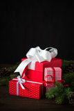 Red christmas present. Beautiful christmas presents in red boxes  at wooden table Royalty Free Stock Photo