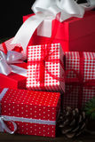 Red christmas present. Beautiful christmas presents in red boxes  at wooden table Stock Images