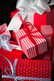 Red christmas present. Beautiful christmas presents in red boxes  at wooden table Royalty Free Stock Photography