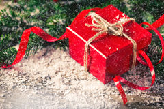 Red Christmas present box with fir and snow wood Stock Image
