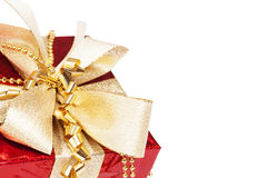 Red christmas present with golden ribbons Royalty Free Stock Photography
