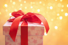 Red Christmas present over blurred light Stock Photos