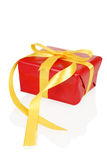 Red christmas present with yellow bow Stock Photography