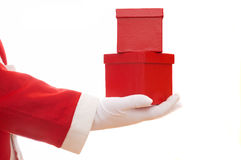 Red christmas presents. Santa giving 2 red christmas presents on white Royalty Free Stock Photo