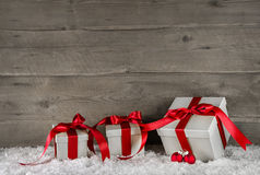Red christmas presents on brown wooden background. Red christmas presents on brown wooden snowy background Stock Photography