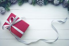Red christmas presents gift box with element of border pine. Royalty Free Stock Images