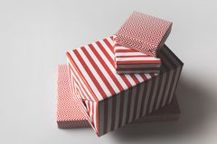 Red christmas presents. Stack of christmas presents in red and white stripes,  on grey Stock Image
