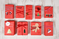 Red Christmas Presents. Top view of a group of Christmas presents wrapped in red paper and decorated in various designs Stock Photo