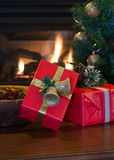 Red Christmas Presents. Two red Christmas presents with tree and fireplace in background Stock Photography