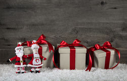 Red christmas presents on wooden grey background with mr. and mr. Red christmas presents on wooden grey background with santa Stock Photography